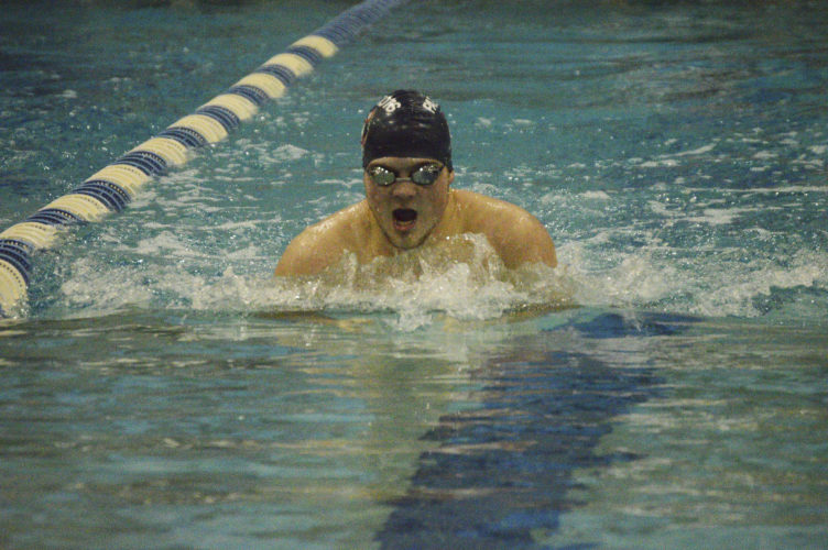 Journal photo by Jessica Manuel Washington's Daniel Carson swims in the 100-yard breaststroke during a meet on Saturday at theShepherd Wellness Center.