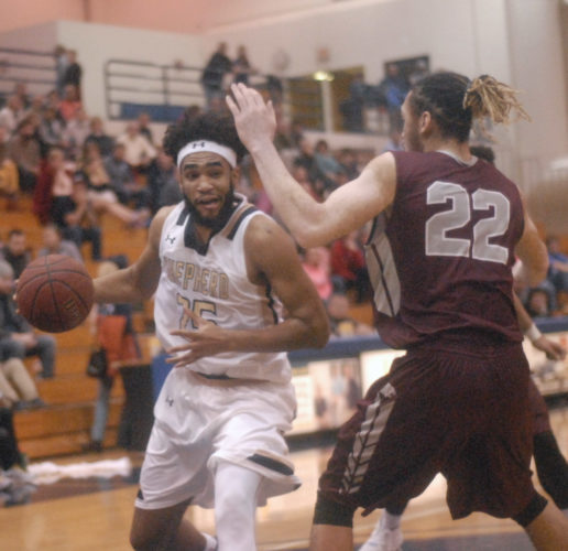 Journal photo by Rick Kozlowski Shepherd's A.J. Carr, left, looks to get past Concord's Stephen Thompson during Saturday's game in Shepherdstown. TheRams won 86-69.