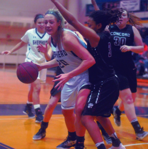 Journal photo by Rick Kozlowski Shepherd's Liz Myers, left, drives to the basket against Olivia Morgan during Saturday's game againstConcord. Myers surpassed the 1,000-point mark in the Rams' loss.