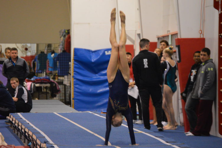 Gymnasts from the Gym Cats team out of Flip Over Gymnastics in Martinsburg participate in the Region 6 competition on Sunday. More than 250 athletes participated in the competition, which featured trampoline, double mini and tumbling events.