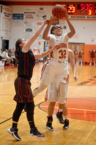 Martinsburg's Cameron Awkard (32) goes up for a shot over Spring Mills Malerie Wratchford (15) Tuesday evening in Martinsburg. See more photos on CU.journal-news.net. (Journal photo by Eric Jones)