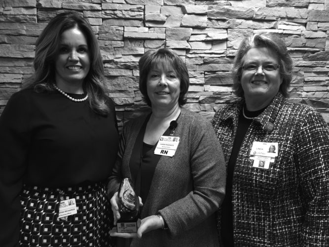 Submitted photos Vice President and Chief Nursing Officer Samantha Richards and ICU Nurse Manager Karen Pezzanite are pictured receiving Berkeley Medical Center's Gold Award.