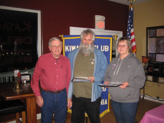 (Submitted photo) Bruce DeHaven, vice president of the Martinsburg Kiwanis Club, inducted Mary and Mike Helmick into the club at a recent meeting. The Martinsburg Kiwanis Club was Chartered in 1921 and is one of the oldest clubs in the country. Through Kiwanis membership, communities are improved, friendships are built, leadership skills are developed and business contacts are made. But more important, the lives of children around the world are changed for the better. The club also sponsors three Key clubs in the county, Hedgesville, Martinsburg, and Spring Mills High Schools. The club is having a campaign to add new members. For more information, call Bruce DeHaven at 304-671-7986.