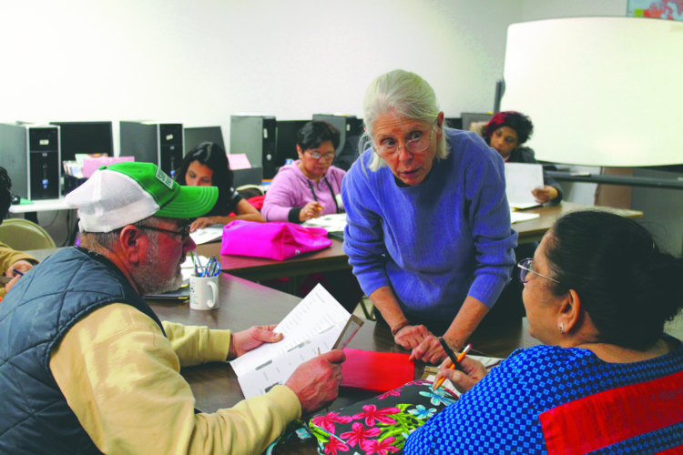 Journal photo by Danyel VanReenen Program founder Jane Wagner teaches students the skills they will need to pass the citizenship test on Tuesday during the weekly class in Jefferson County.