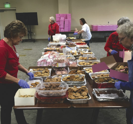 Volunteers assemble an assortment of cookies to be delivered as part of Hospice of the Panhandle's annual Valentine's Cookie Project. (Submitted photo)