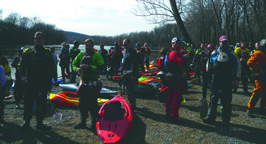 (Journal photo by Jim McConville) Kayakers get ready to launch along the Shenandoah River in Millville on Saturday in a memorial tribute to fellow kayaker Dave Kersey, who took his life while kayaking on the Potomac River on Feb. 11.