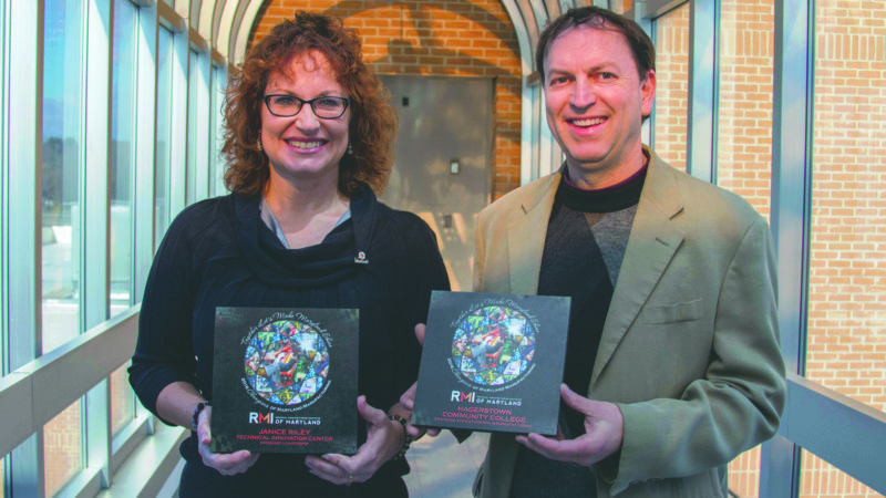 Submitted photo Janice Riley, left, TIC manager, and Ed Bass, right, advanced manufacturing instructor, hold their RMI awards.