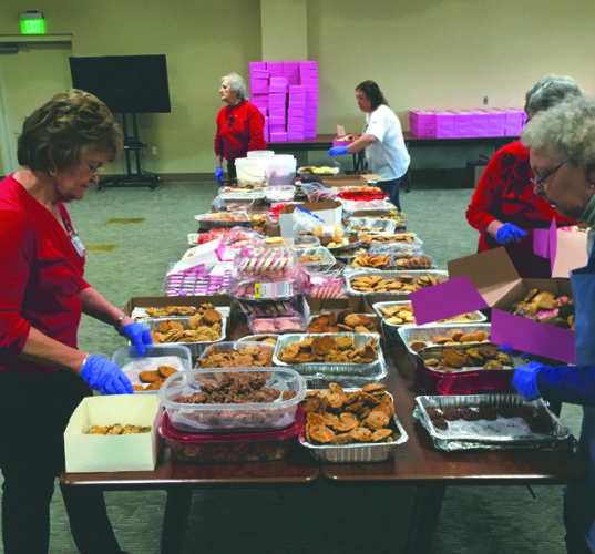 Submitted photo Volunteers assemble an assortment of cookies to be delivered as part of Hospice of the Panhandle's annual Valentine's Cookie Project.