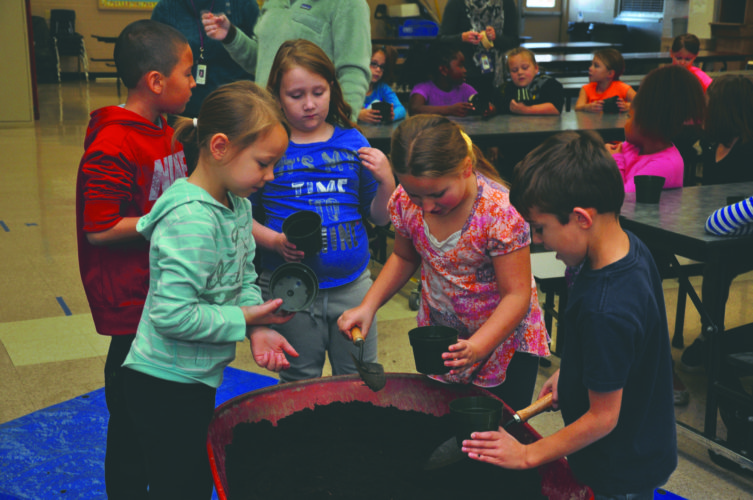 Submitted photo Marlowe Elementary School students in Falling Waters plant a herb garden in the school cafeteria.