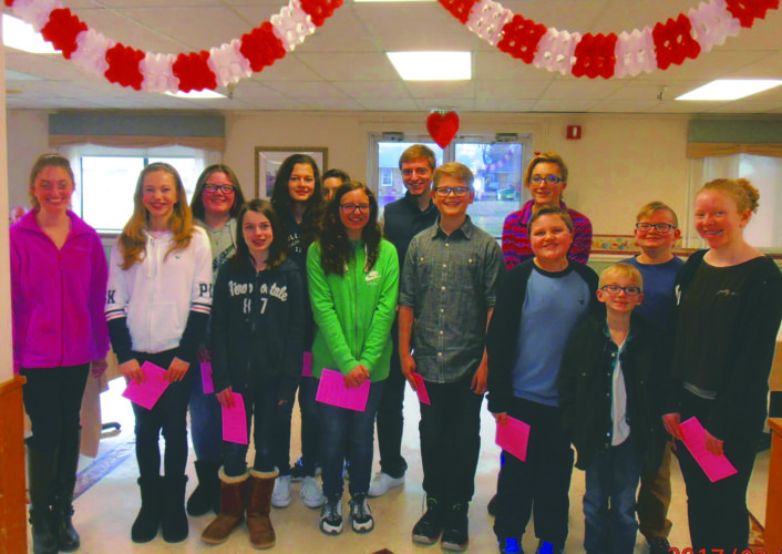 Submitted photo Members of the Hedgesville Middle School and 4-H Youth Leadership groups joined forces recently to spread love at Clary Grove Nursing Home. They delivered Valentine gifts and sang love songs.