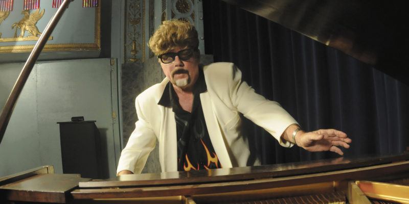 """Jerry Mullenix, Singer Entertainer, performs the Jerry Lee Lewis rock classic, """"Great Balls of Fire"""" at the 13th annual Apollo Community Talent Show Extravaganza.  (Journal photo by Ron Agnir)"""