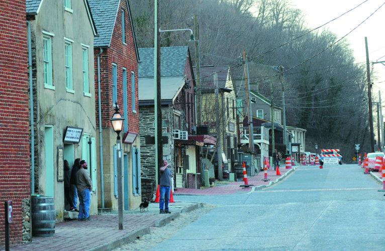 Journal photo by Ron Agnir Tourists wander along Potomac Street through Lower Harpers Ferry Wednesday afternoon.
