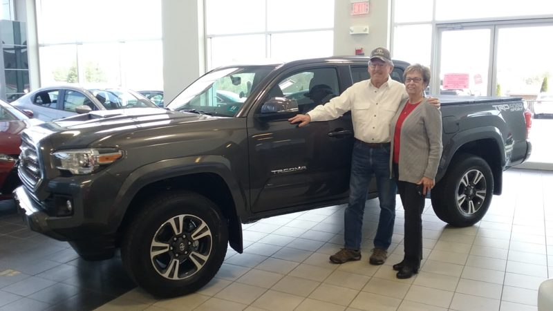Donald and Susan Tharpe are shown next to their new 2017 Toyota Tacoma. (Submitted photo)