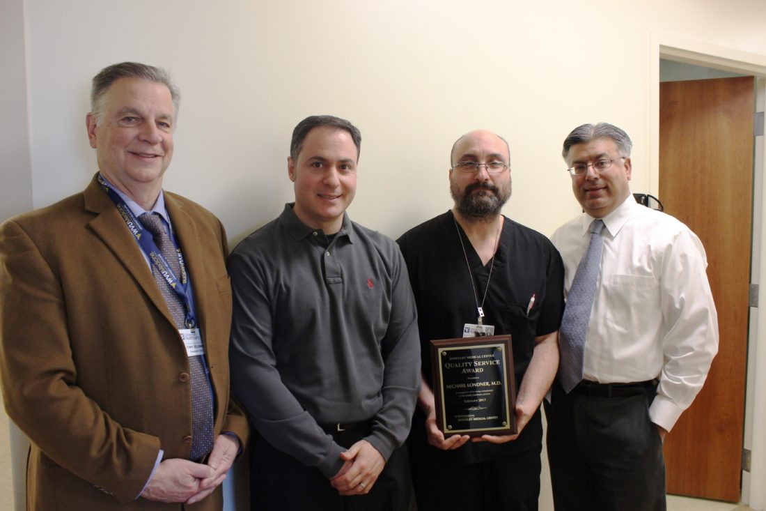 WVU Medicine Berkeley Medical Center's February Quality Service Award winner is pictured receiving his award.  Left to right:  Anthony P. Zelenka, president and chief executive officer; Christopher Gentle, MD, emergency services medical director; February QSA Winner Michael Londner, MD; and Rohit Gulati, MD, vice president/chief medical officer. (Submitted photo)