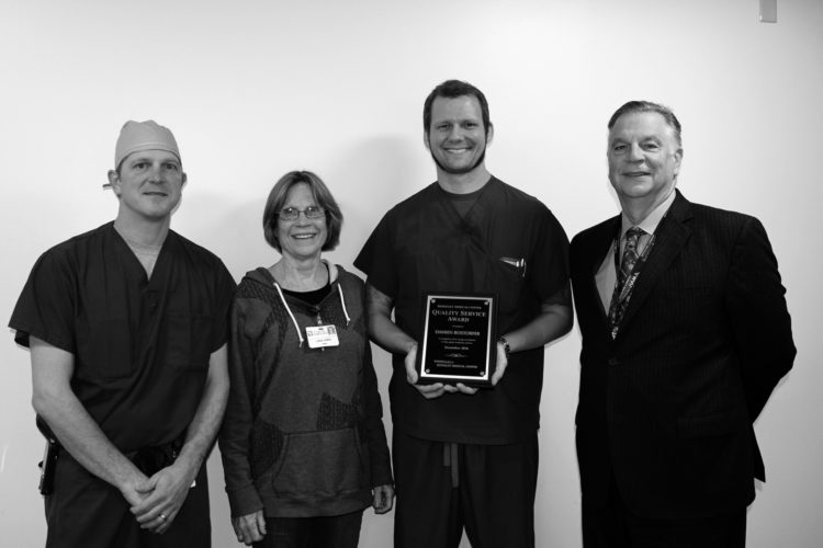 Submitted photo WVU Medicine Berkeley Medical Center's December Quality Service Award winner is pictured receiving his award. Pictured, from left to right, are CRNA Co-Chiefs Jason White and Linda Jones; December QSA Winner Damien Rostorfer, and WVU Medicine University Healthcare President and CEO Anthony P. Zelenka.