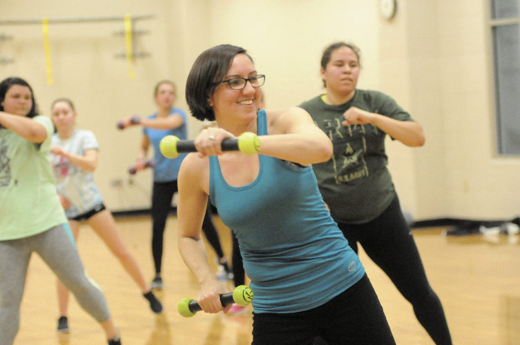"Mary dances while using 1 pound weights euphemistically referred to as ""maracas"" by the Zumba Dance Class at Shepherd University Wellness Center. (Journal Photo by Ron Agnir)"