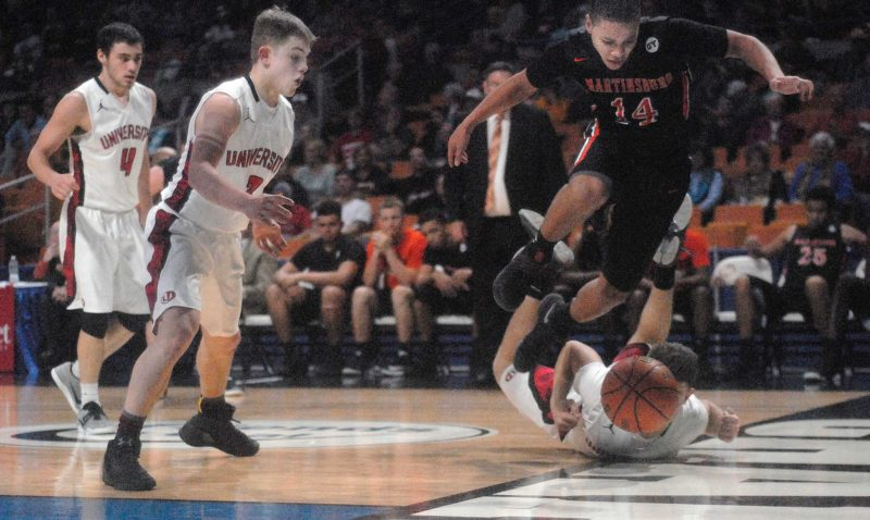 Journal photo by Rick Kozlowski Braxton Wright, right, of Martinsburg tries to avoid University's Austin Forbes as the ball goes out of bounds in the second half of the Bulldogs' loss to the Hawks on Wednesday.