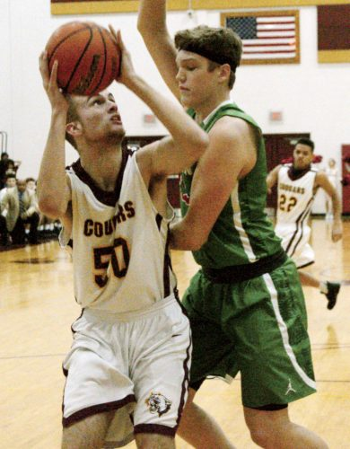 Journal photo by Jessica Manuel Musselman's Jake Stephens, right, defends Jefferson's Justin Hall during theClass AAA, Region II co-final.
