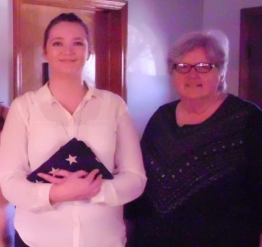The flag chair, Jacqueline Dayhuff, pictured with member Pamela Brush, is holding the American flag following a flag-folding workshop for the William Henshaw Chapter NSDAR (Submitted photo)