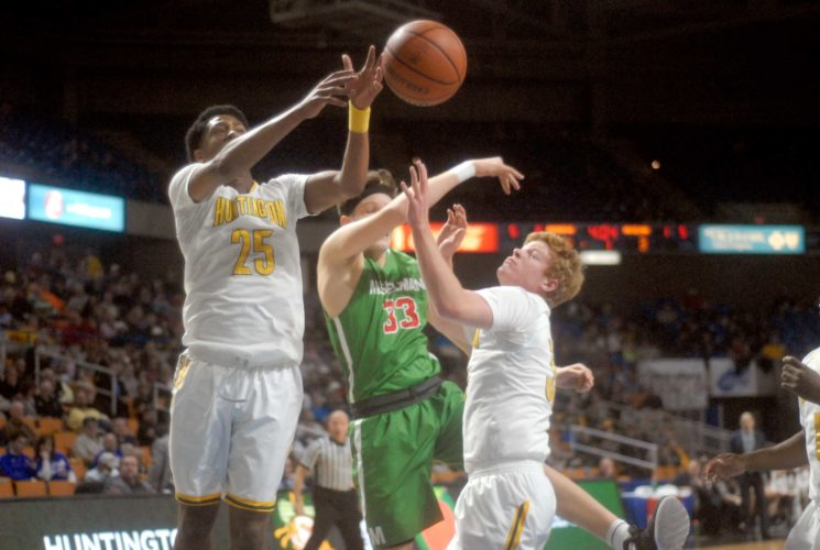 Journal photo by Rick Kozlowski Musselman's Jake Stephens battles for the ball with Huntington's John Dawson and another Highlander defender during Thursday night's Class AAA boys basketball state tournament quarterfinal game.