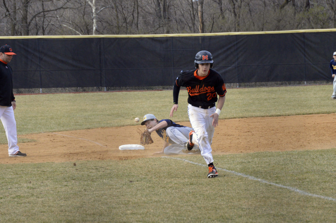 Journal photo by Jessica Manuel Martinsburg's Noah Dobson, right, heads for home plate after a single down the left-field line by Hunter Metzger during the second inning of the Bulldogs' win over Moorefield.