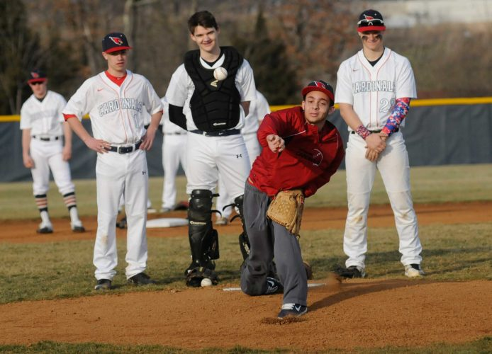 Spring Mills' Trey White throws out the first pitch of the East Hardy-Spring Mills baseball game Tuesday afternoon. The former Spring Mills athlete was was diagnosed with congestive heart failure, two years ago and needed a new heart to continue to live. (Journal photo by Ron Agnir)