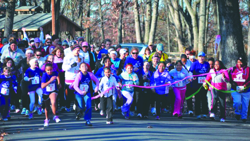 Submitted photos Girls take part in a 5K race last fall. A Girls on the Run 5K event will be held May 20 at the Driswood Elementary School in Shenadoah Junction and the Jim Barnett Park in Winchester, Va.