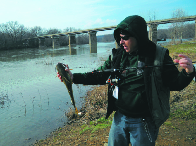 Journal photo by Ron Agnir Jason Havelt of Frederick, Md., reels in a channel catfish from the Potomac River near Williamsport, Md., on Tuesday afternoon.