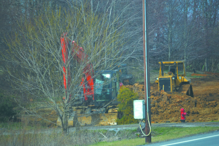 (Journal photo by Mary Stortstrom) Workers and equipment for a Jefferson Utilities Inc. project on North Mildred Street in Ranson are seen on Tuesday afternoon. The project will connect two water systems in Jefferson County, according to Jefferson Utilities staff.
