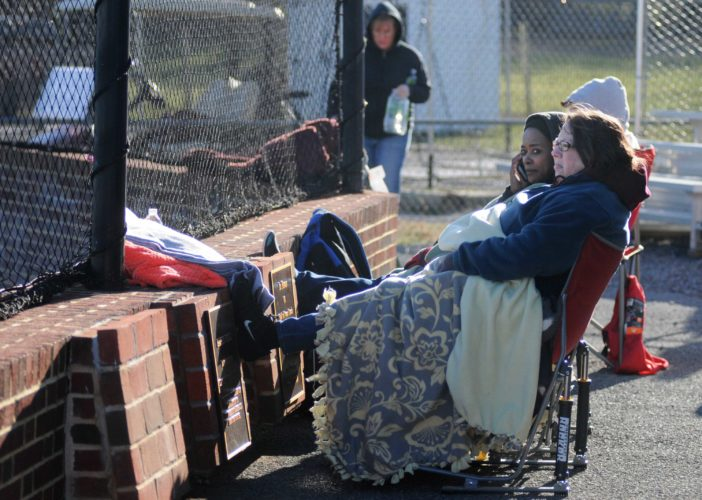 (Journal photo by Ron Agnir) April Tennant, left, and Dee Dee Bender bundle up under layers of coats and blankets to cheer on the Jefferson Cougar baseball team, despite the 40 degree weather Wednesday afternoon in Shenandoah Junction. Jefferson won 6-3.