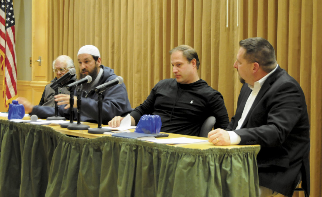 Pictured, from left, Tariq Husain, Imam Faruq Post, Rabbi Ari Plost and Pastor Joel Rainey participate in an interfaith dialogue on Thursday at Shepherd University. The purpose of the event was to develop a deeper understanding and appreciation of the unique and common features of different faiths. (Journal photo by Ron Agnir)