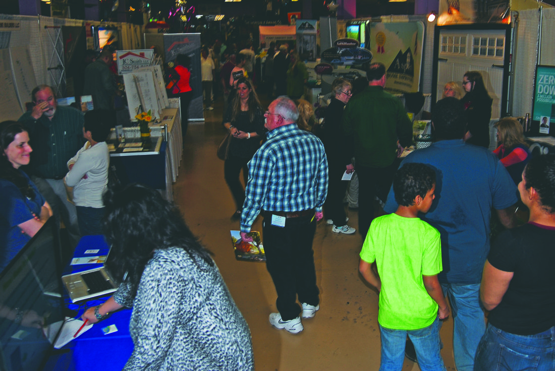 (Journal photos by Jeff McCoy) Vendors and shoppers mix at the annual Eastern Panhandle Home Builders Association Home Show at 215 Monroe St., on Saturday in Martinsburg.