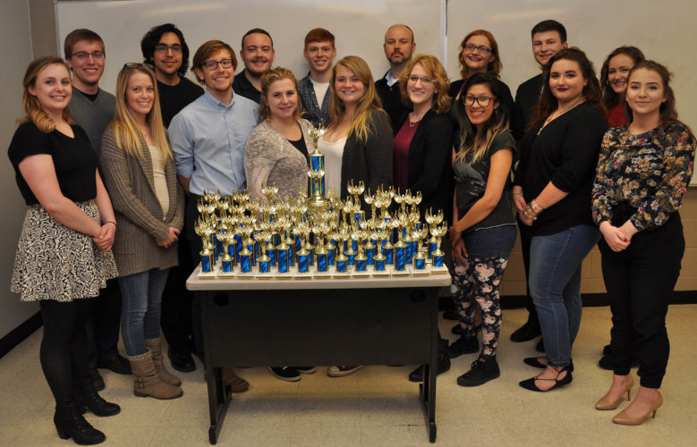Shepherd University's Debate Team brought home many trophies from the tournaments they participated in this year. Pictured in the front row, from left, are Logan Kerr, a political science major from Inwood; Desiree Rose, a political science and economics major from Hedgesville; Will Wheatley, a political science major from Harpers Ferry; Katie Zakrzewski, a political science major from Berkeley Springs; Jenn Dickey, a business major from Mt. Airy, Maryland; Meredith Blady, a psychology major from Martinsburg; Karen Paiz, a political science an psychology major from Silver Spring, Maryland; Mikayla Duhaime, a political science major from Saratoga Springs, New York; and Madison Ronevich, a political science major from Inwood. Back row, Garrett Spiker, a political science major from Bunker Hill; David Bennett, an English major from Hedgesville; Lance Wines, a political science major from Winchester, Virginia; Casey Feezle, a political science major major from Augusta; Joseph Robbins, chair of the Department of Political Science and Debate Team advisor; Lauren Duckworth, a psychology major from Kingwood; Samuel Brown, a political science major from Charles Town; and Maggie Nevin, an English major from Martinsburg. (Photo courtesy of Shephard University)
