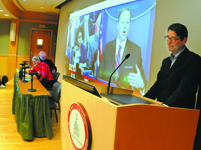 Journal photos by Ron Agnir Panelist Dr. Aart Holtslag, assistant professor of political science, uses a video of White House Press Secretary Sean Spicer getting into a heated exchange with American Urban Radio Networks' correspondent April Ryan as he discusses the importance of issue framing, spin, deflection and weighing facts, and the way those technique shape how individuals process information during a Teach-in on Fake News and Polling at Shepherd University on Wednesday afternoon.