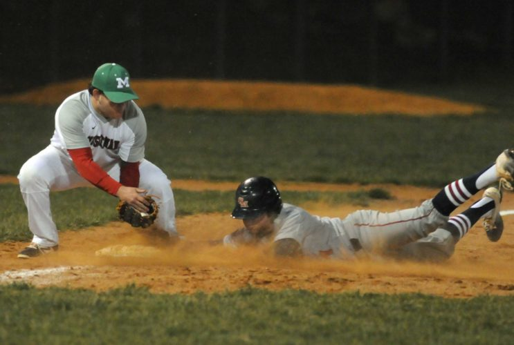 Spring Mills' Colton Henson, right, slides into third base under the tag of Musselman's Dylan Brewbaker during the third inning Thursday evening in Inwood. See more photos on CU.journal-news.net. (Journal photo by Ron Agnir)
