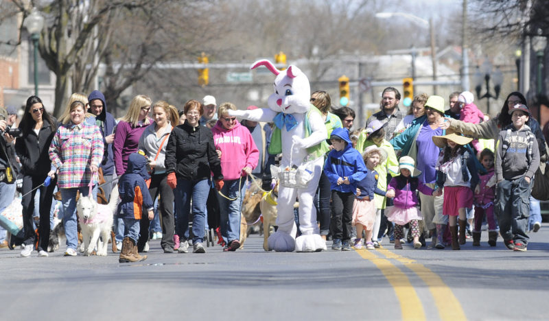 Happy throng of pets and pet lovers march up N. Queen Street in a previous Main Street Martinsburg's Easter Pet Parade Sat. morning. (Journal Photo by Ron Agnir)
