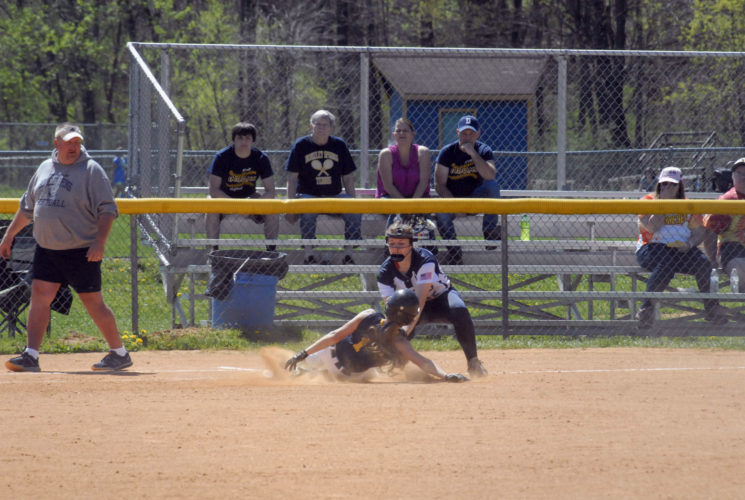 Berkeley Springs' Payton Brown slides into third as Hedgesville's Kelsie Turben applies the tag. Brown was out on the play.