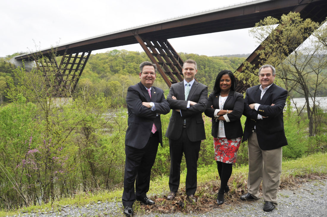"Delegates Paul Espinosa, R-Jefferson; Riley Moore, R-Jefferson; Jill Upson, R-Jefferson; and Harpers Ferry resident Scot Faulkner proudly stand in front of the bridge they were successful in naming the ""Major Martin Robison Delany Memorial Bridge"" after the highest ranking African-American officer in the Civil War. (Journal photo Jeff McCoy)"