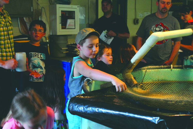 (Journal photo by Danyel VanReenen) Children and parents enjoy touring the Leetown Science Center on Friday in celebration of Earth Day.