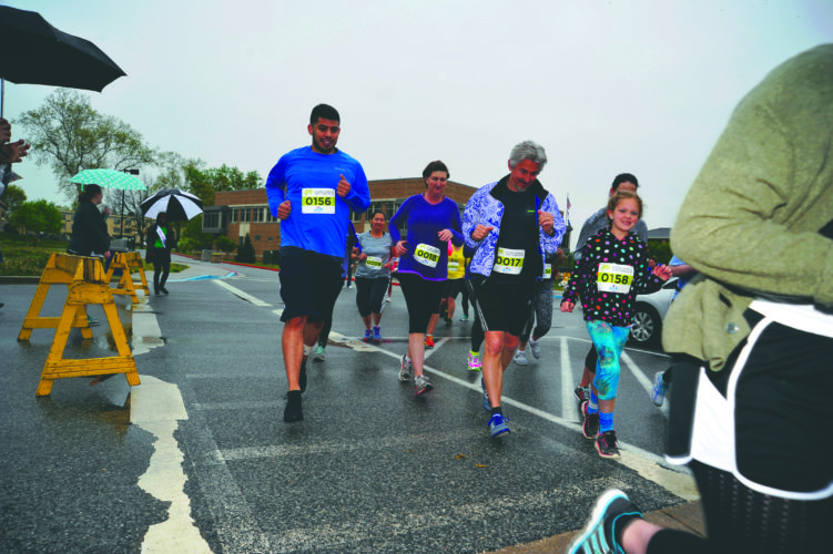 (Journal photo by Jeff McCoy) Runners of all ages participate in the Shenandoah Women's Center 3D dash 5k run Saturday at Shepherd University to help raise needed funds for the center.