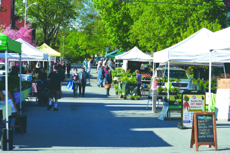 Journal photo by Adranisha Stephens Locals stroll through the Shepherdstown Farmers Market on Sunday morning.