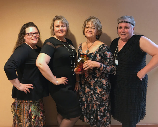 Shown, from left, are Katrina Stevens, assistant volunteer coordinator; Tricia Lawrence, volunteer coordinator; Cheryl Gregory, Volunteer of the Year; and Wendy Moreland, human resources director. (Submitted photo)
