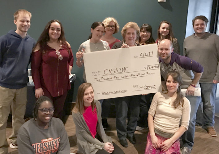 HCC students pose with presentation check. Almost $2,500 was raised as part of a class project. (Submitted photo)