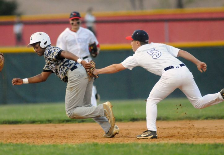 Spring Mills' Evan Meyer, right, tags out Hedgesville's Calvin Covington in a rundown between second and third base during the third inning of Thursday's game in Spring Mills. See more photos on CU.journal-news.net. (Journal photo by Ron Agnir)