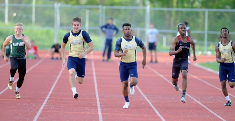 Journal photo by Ron Agnir Hedgesville's Kyrae Ramos (middle) wins the boys 100-meter dash at The Journal/Hedgesville Eagles Track Meet Friday at Poisal Park. See more photos on CU.journal-news.net.