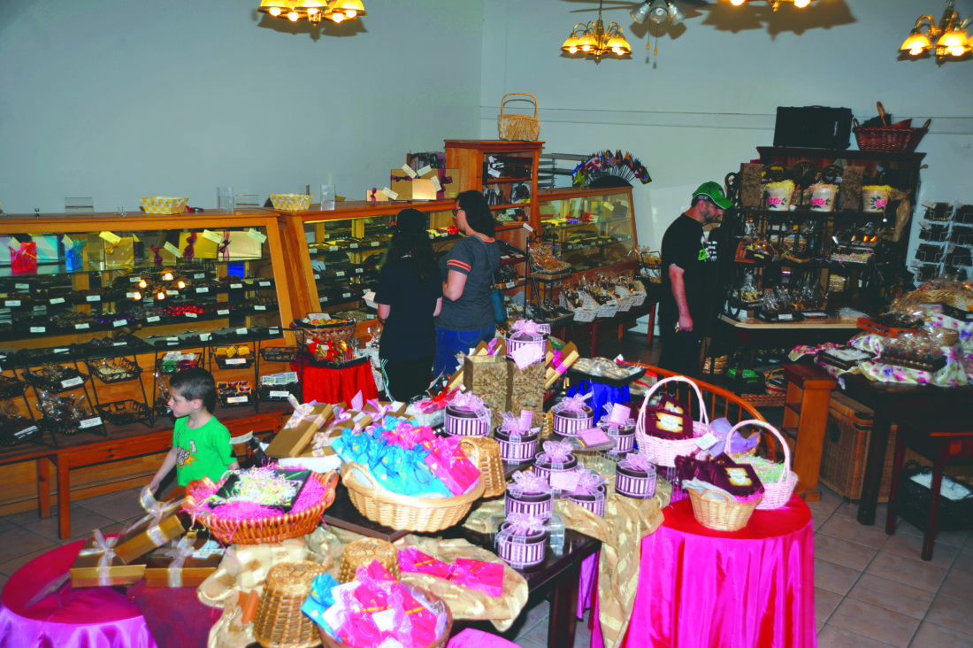 DeFluri's Fine Chocolates storefront shop in Martinsburg was crowded with people during the 2017 Chocolate Fest Book Faire. Many watched a video on how chocolate and candy was made.