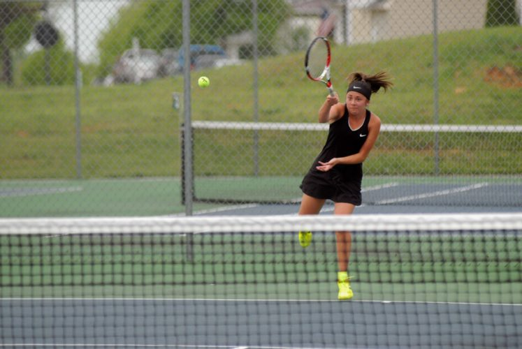 Madison Chen of Jefferson returns the ball during No. 1 singles play in the Eastern Panhandle Athletic Conference tournament. She won the individual title. (Journal photos by Eric Jones)