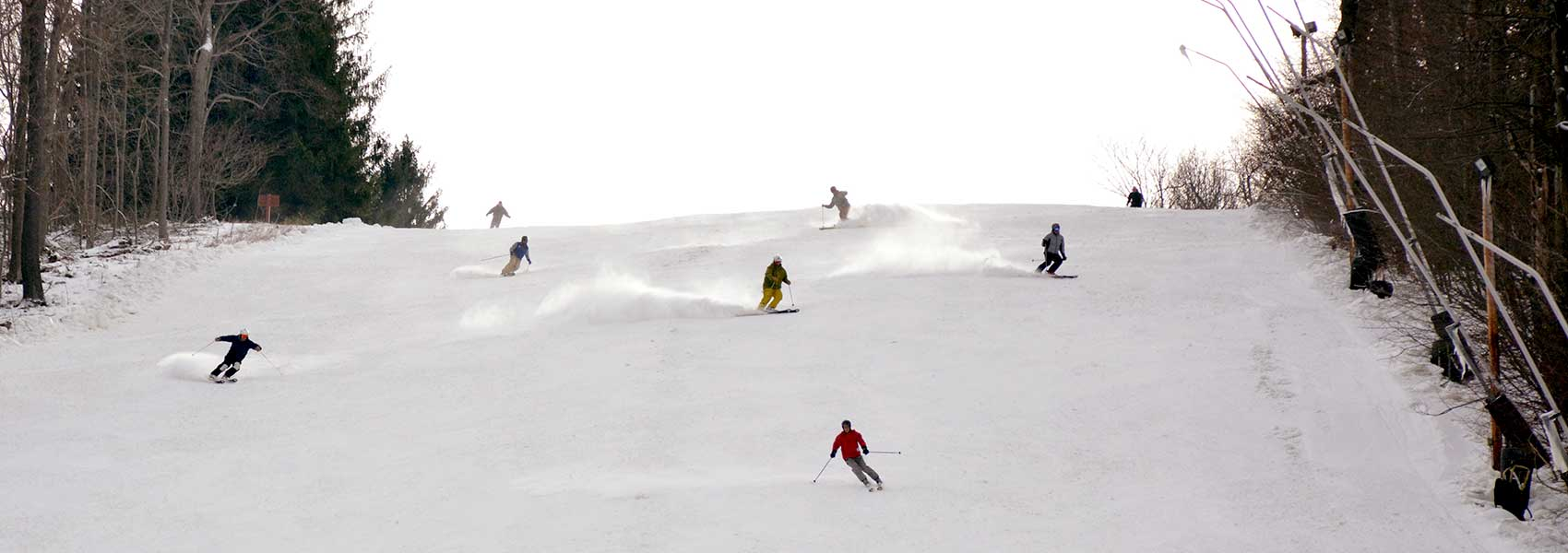 opening-day-skiers-coming-down-slope
