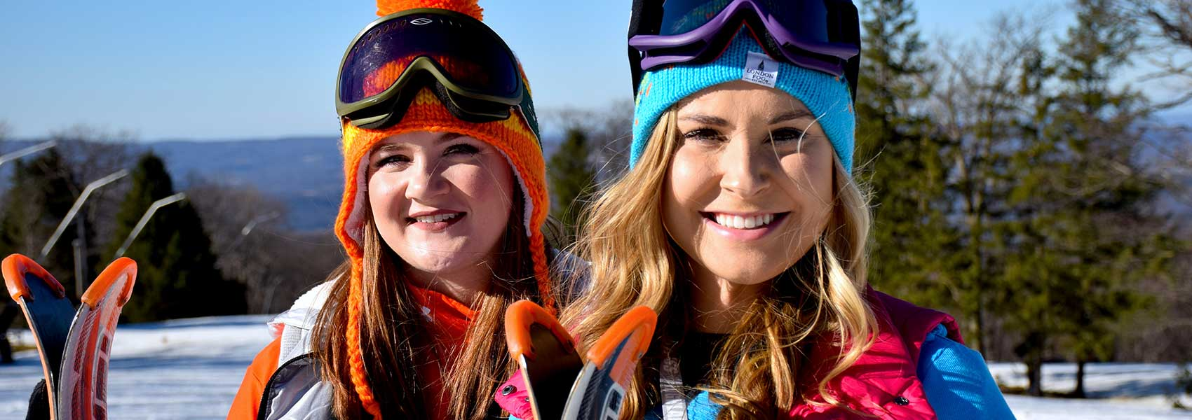 two-female-skiers-smiling