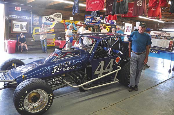 Dave Lape stands next to his restored 1977 Tobias chassis modified that he drove to the 1977 Mr. DIRT championship and 10 feature wins at Fonda Speedway on June 25 at the Fonda Speedway Museum at the Montgomery County Fairgrounds. (The Leader-Herald/James A. Ellis)